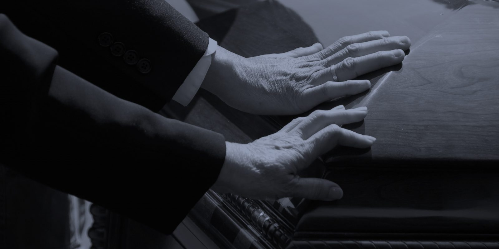 Medical malpractice wrongful death hands on coffin